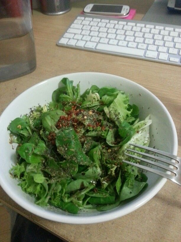Green salad with apple cider vinegar and herbs