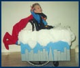 Halloween costumes for kids in wheelchairs including Superman costume