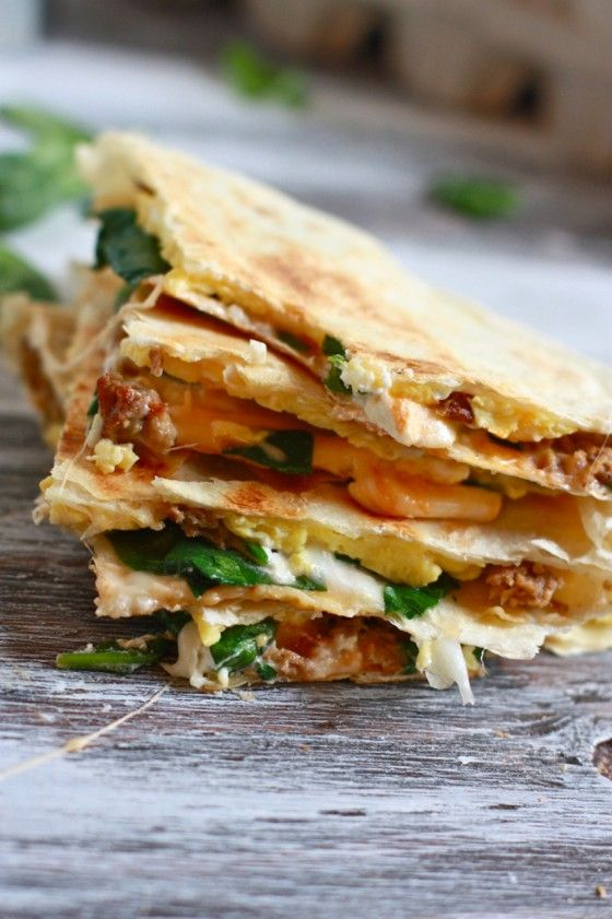 breakfast quesadillas with eggs, sausage, goat cheese, mozzarella, and baby spinach