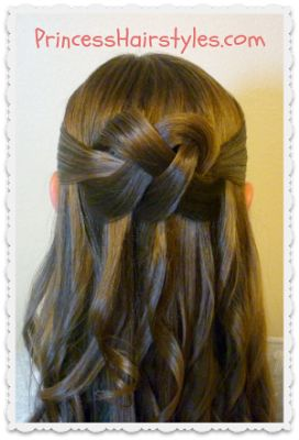Woven Knot, half up half down hairstyle tutorial - super cute but I don't think it would stay during a school day. Maybe for church or a holiday look?