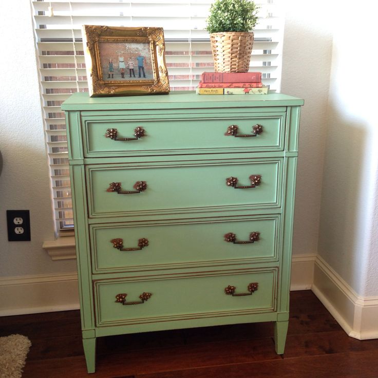 The perfect mint green color! I used equal parts of Annie Sloan's Antibes green, Old White and Duck Egg! Lightly distressed around the edges!