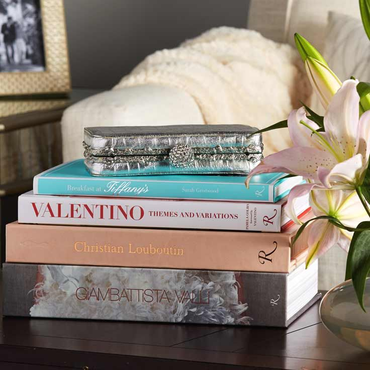 Stack fashion books on a coffee table. Home Decor