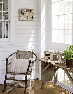 love the sun room look of this porch