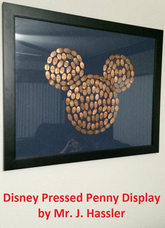 """This Disney Pressed Penny display was created by Mr. J. Hassler - The trick is to go to a coin dealer and buy rolls of pennies from before '82 when they were still all copper.... they press the best.  This one is about 200 pennies. Just use a strong craft clue to hold them in place on  a piece of colored foam core.  This frame is 22""""x28"""""""