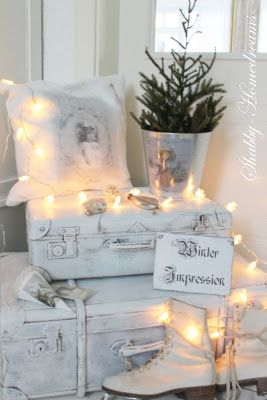 Loving the vintage/shabby white with the lights for Christmas