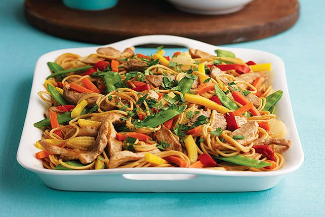 Stir up this version of a Chicken Lo Mein with chicken, crunchy peppers & smooth peanut sauce. This easy recipe is our version of a…
