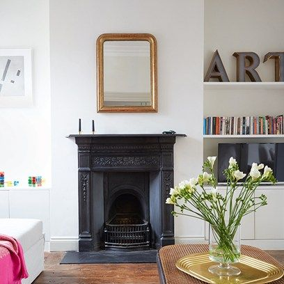 The furniture in the sitting room of Caroline O'Donnell's London flat is a blend of classic contemporary designs and understated antiques and vintage pieces
