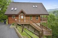 Luxury Lookout is a romantic 1 bedroom cabin in Gatlinburg with breathtaking mountain views. Guests will enjoy a hot tub, pool table, and theater room.