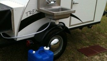 OUTSIDE SINK Simple Sleeper Teardrop Camper by Trekker Trailers