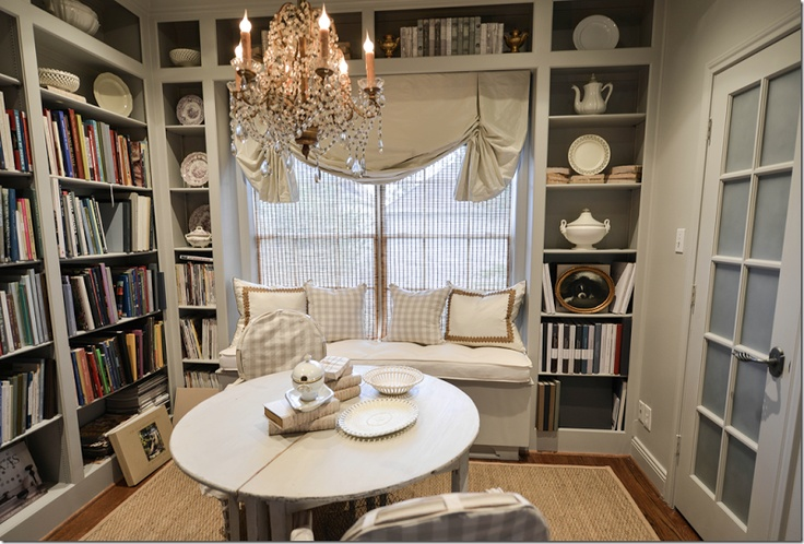 small space turned into great organization with built in bookcases, that also gave  built-in window seat.