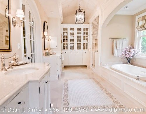 Great layout with french doors and beautiful cabinetry. I love the arched mirrors (I would choose the black or bronze finish, though).
