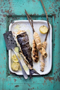Snoek braai with stokbrood (fire grilled snoek with bread baked on the fire...), a traditional West Coast meal. By runnersworld.co.za