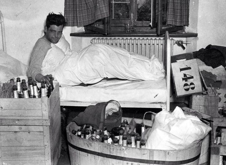 Capt. Lewis Nixon of Easy Company, the morning after V-E Day. The booze comes from Hermann Göring's house.