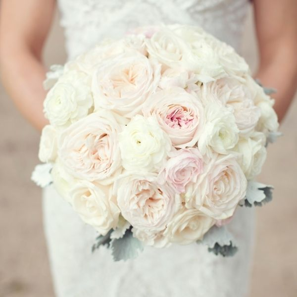 the bride carried a rounded bouquet of blush and ivory roses that were finished with a subtle touch of greenery the bride carried a rounded bouquet of - Blush Garden Rose Bouquet