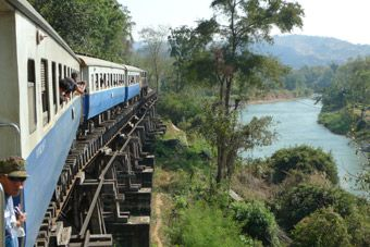 The 12:55 from Nam Tok to River Kwai Bridge, Kanchanburi & Bangkok passes over the Wampo Viaduct along the River Kwai...