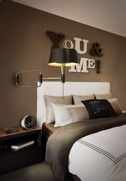 This is adorable! Separate letters hung on the wall... you could write anything (those this is so cute for a master bedroom). I love how they fit them together and the two different colors.