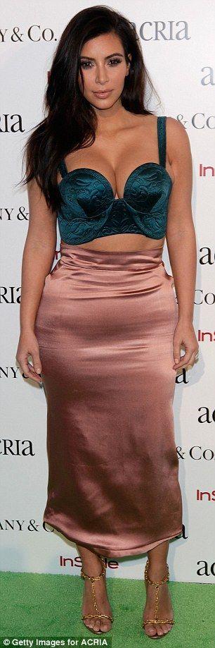 Kim Kardashian squeezes into bra as Alessandra Ambrosio looks leggy #dailymail