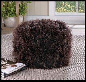 Brown Pouf Ottoman - Living Room Decor - Rest your tired feet after a hard day at work with this comfy ottoman. www.mysouthernhomeplace.com