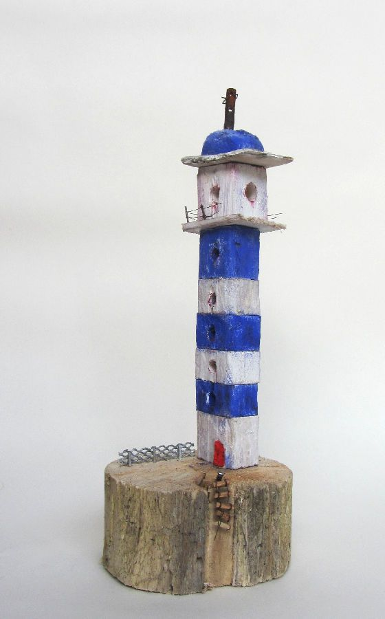 Lighthouse with ladder made from driftwood.