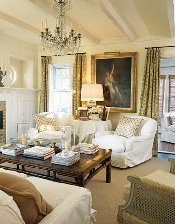 Living room walls and trim are Benjamin Moore Golden Straw and Cloud White, respectively. Sofa and club chairs are Henredon for Ralph Lauren. Pillow and curtain fabric from Schumacher. An Asian dining table was cut down to coffee-table height. Photo by Nathan Schroder  - HouseBeautiful.com