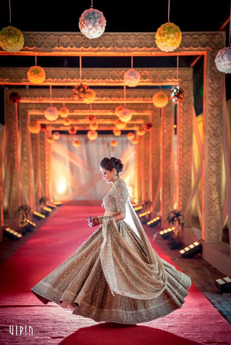 Twirling Bride - Gold Light Lehenga | WedMeGood | Twirling Bride in a Gold Sequinned Lehenga with Hanging Flower Decor #wedmegood #indianbride #bridal #indianwedding #lehengas #twirling