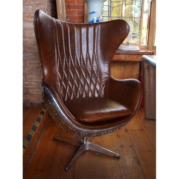 Leather and aluminium Aviator style wing back chair. Pure style and class £1260.00
