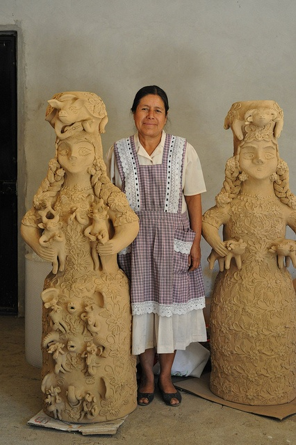Master ceramic artist Irma Garcia Blanco stands between two of her amazing creations in clay. Santa Maria Atzompa, Oaxaca, Mexico