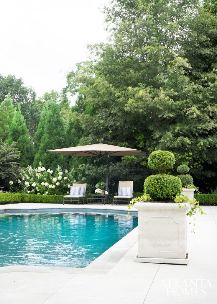 This Serene Outdoor Area Which Includes A Swimming Pool And Adjacent Brick Pavilion Creates