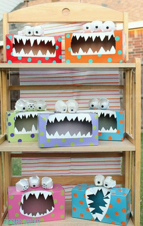 Valentine's day boxes that are monsters! Made out of tissue boxes. I love making crafts out of everyday items! I am going to do that!