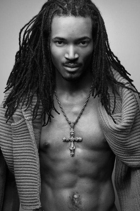 DOUBLE YIKES. no belly showing would have been better.  hes a handsome young man. love the braids.