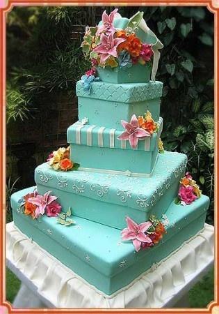 Floral Cake  A square aqua blue wedding cake with flowers.