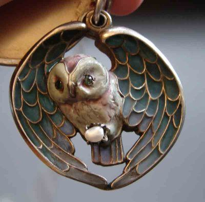 Meyle and Mayer sterling and plique-à-jour enamel owl locket, with the owl holding a natural Baroque pearl in its claws. Late Arts and Crafts/early Art Nouveau period.
