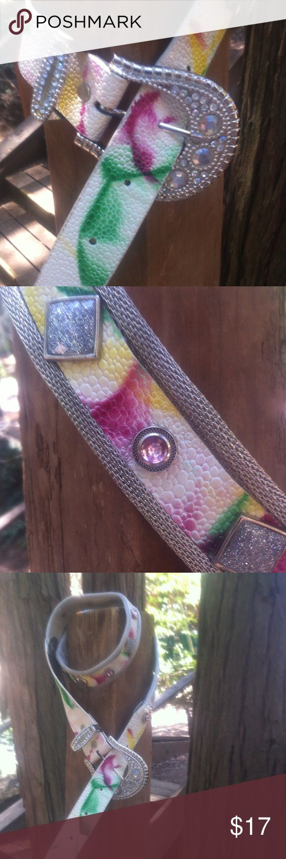 Hold...Creamy western bling belt Cream  textured leatherette, belt with a bit of bright color accent on silver mesh, with plenty of rhinestone bling, western up your outfit, a 'Kristens Find' overall length is 44, to the first buckle hole35,this belt is free with the purchase of $15 or more,just tag me... a 'Kristens Find' .Posh on, girlfriend;) Accessories Belts