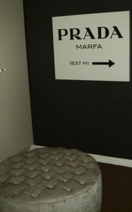Round deep buttoned ottoman & Prada canvas as entrance to Monochrome french bedroom