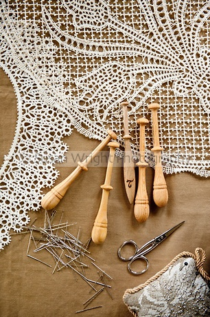 Pillow lace or bobbin lace 'merletto a tombolo' made from 100% linen thread using wooden bobbins (fuselli or piombini)