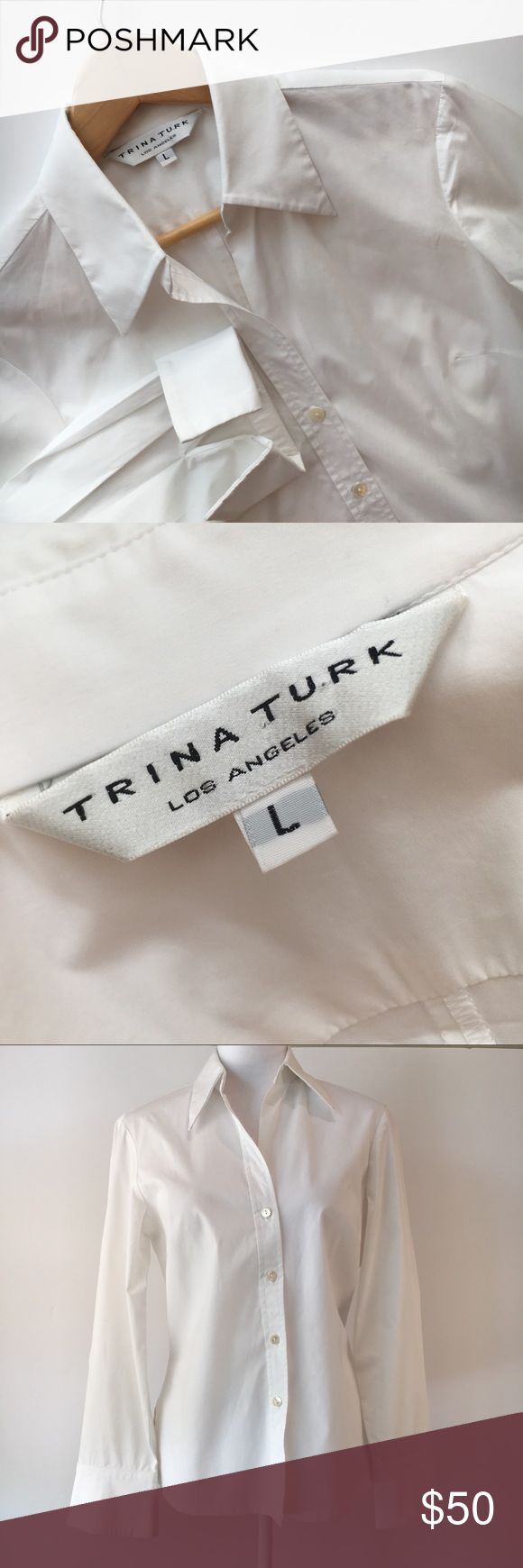 """Trina Turk white work French cuffs career shirt L Crisp, classic white Trina Turk fitted button-down shirt—an essential for smart style in the office and beyond. Pointed collar and French cuffs. Wear extra-long cuffs folded back and closed with cufflinks or fabric knots, or go casual with an undone-cuff look. 96% cotton, 4% polyurethane for great fit and stretch. EUC. No marks, holes, or pills. Size large. Approximate measurements: Bust (armpit to armpit) = 20"""", length (shoulder to hem)…"""