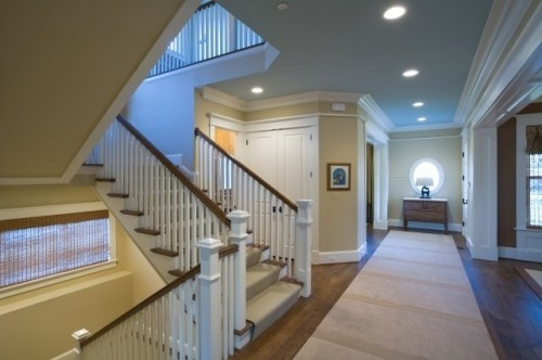 A take on the new houses foyer reversed with open concept with vaulted ceilings into living room.