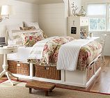 I love the baskets under the bed, great for smaller bedrooms to add storage space...now if only I could afford it!