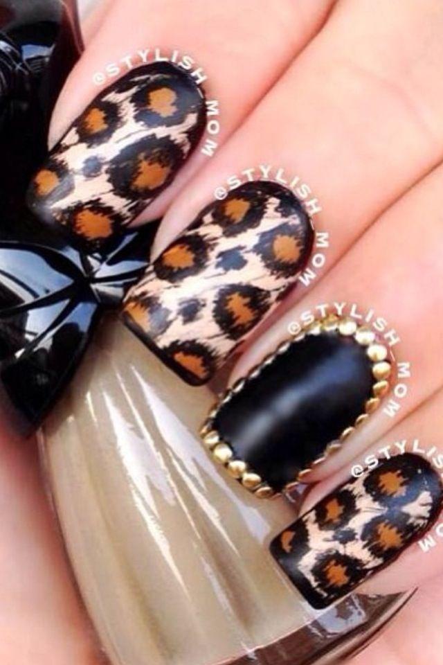 Black leopard & gold nails.