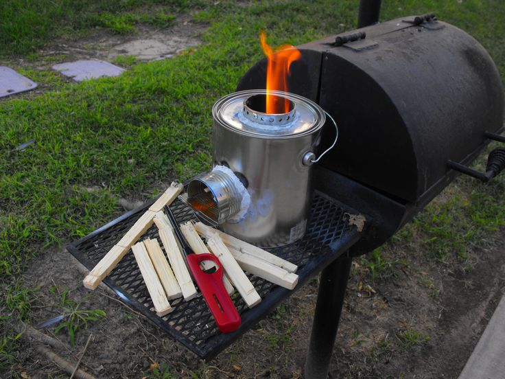 """This is a """"Rocket Stove"""" that I built out of 4 soup cans and an empty gallon paint can. I filled it with sand from my son's sandbox to insulate it so that the paint can won't be hot to the touch. This thing works great! I plan on building more of them and even one out of a 55 gallon steel drum."""