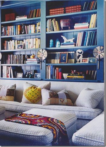 Love the blue and the great bookshelves in easy reach of the sofa!  :)