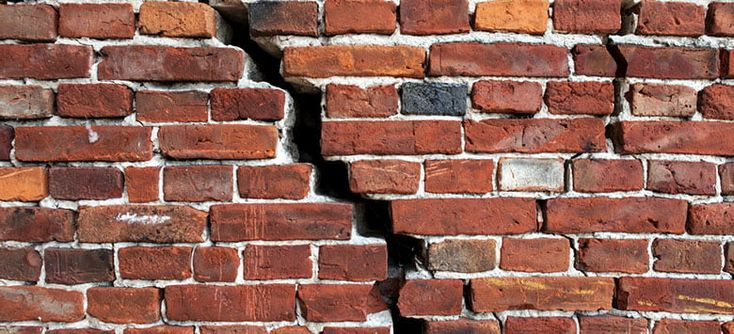 Brick wall cracks types dangers cause and fixing