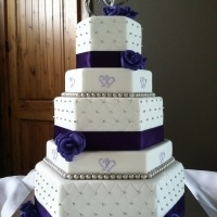 two-hearts-themed-purple-and-silver-hexagon-wedding-cake