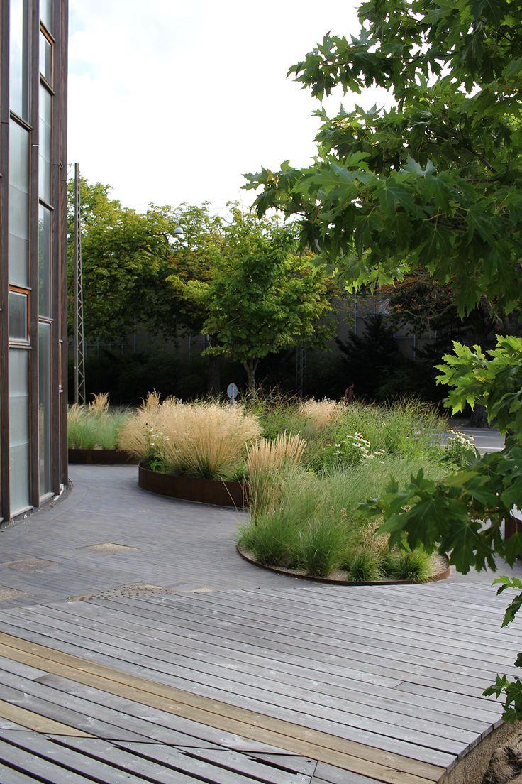 corten planters inset into decking