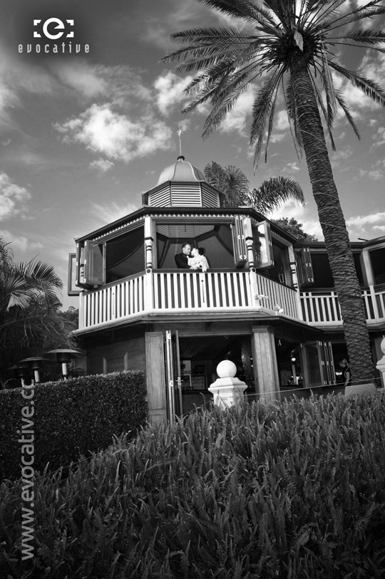 The happy couple on the balcony of the magnificent homestead, in black and white, at Glengariff Historic Estate and Winery. #WeddingPhotography