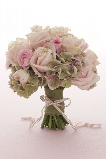 Hand-tied bouquet of hydrangeas, 'Old Dutch' roses and 'Majolica' spray roses