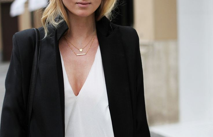 Black blazer, white v-neck, simple necklaces.