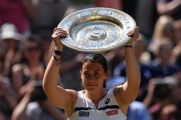 France's Marion Bartoli poses with the winner's Venus Rosewater Dish after beating Germany's Sabine Lisicki in the women's singles final (Getty)