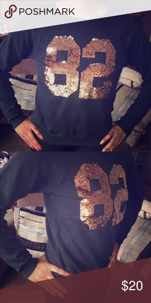 Forever 21 black/gold sequins sweatshirt Black sweatshirt with number 82 in gold sequins. No damages and in good condition! Forever 21 Tops Sweatshirts & Hoodies