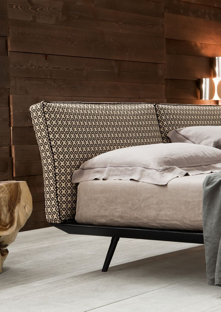 A contemporary bed design, with a streamlined base and a box cushion headboard design, is available in a variety of colour and pattern combinations.
